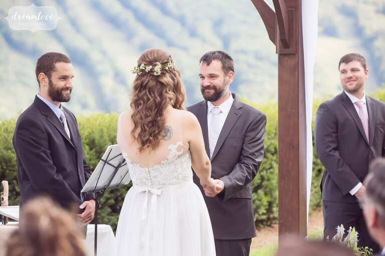 Candid wedding photo of the groom looking at bride during Warfield House Inn wedding ceremony in western MA.