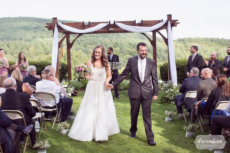 Bride and groom exit their ceremony at the Warfield House Inn in Charlemont, MA.
