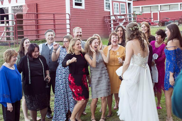 A large group of excited women greet the bride after her ceremony in western MA.