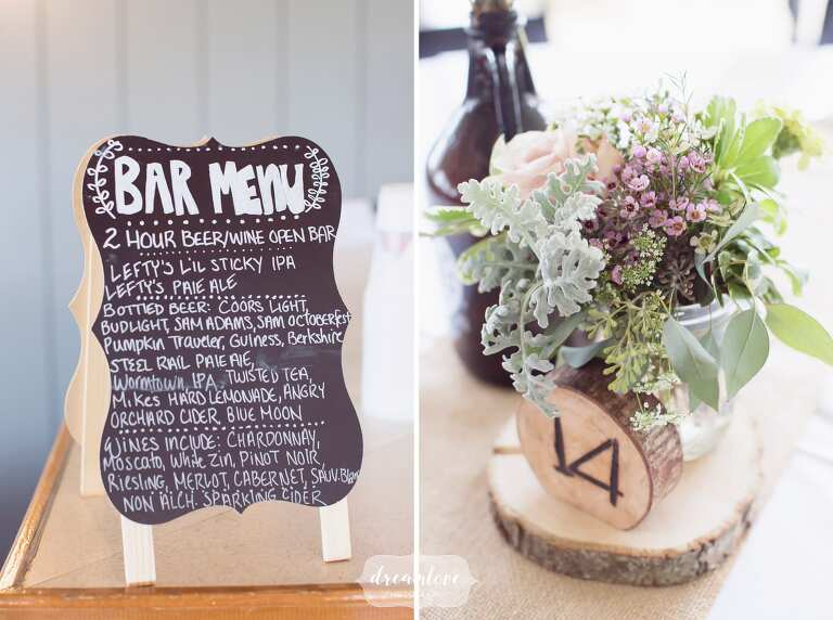 Chalkboard signs and wood slices as decor at this western MA wedding at the Warfield House.