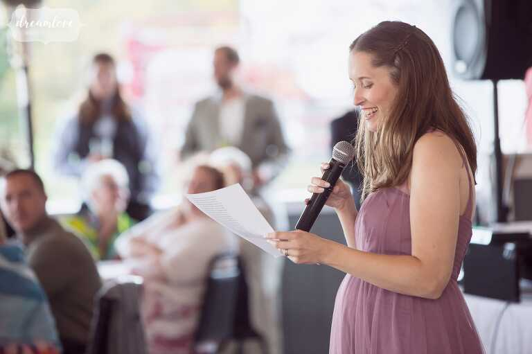 The maid of honor gives a toast at this white barn wedding reception in western MA.