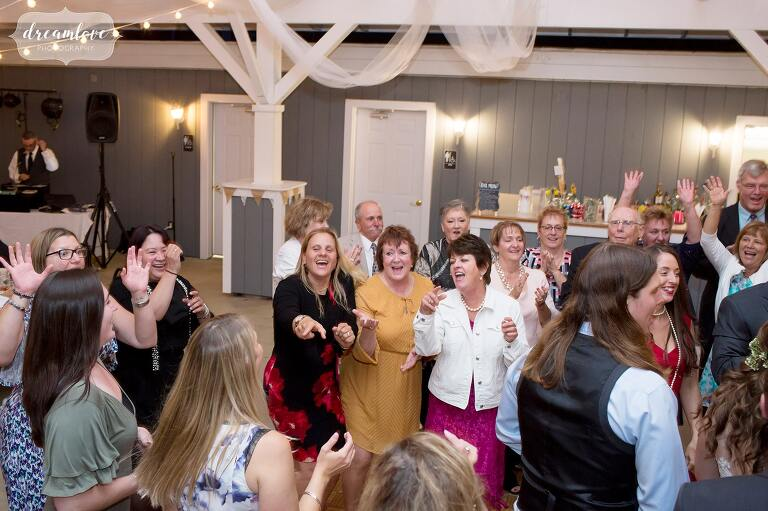 Guests dance at this wedding reception at the Warfield House Inn.