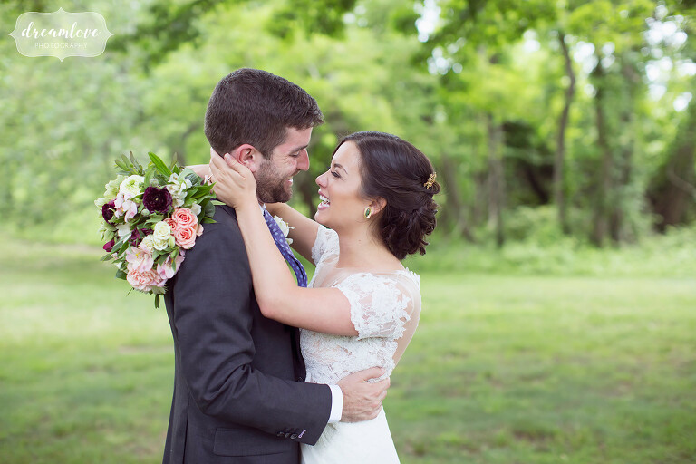Bride and groom have romantic hug at their NY camp wedding.