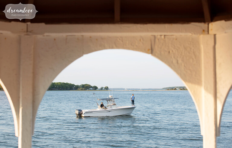 People fish off Shelter Island during this Camp Quinipet wedding on Shelter Island, NY.
