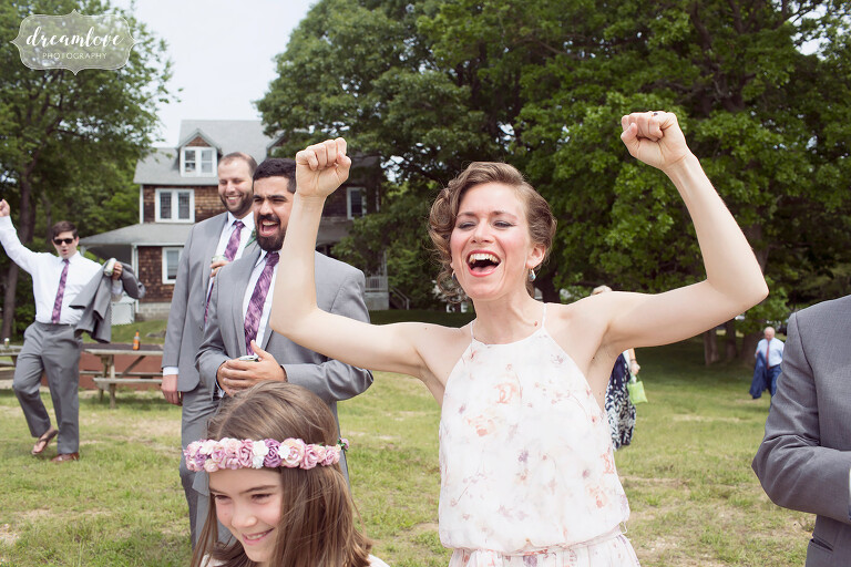 The wedding party cheers on the bride and groom at this NY camp wedding.