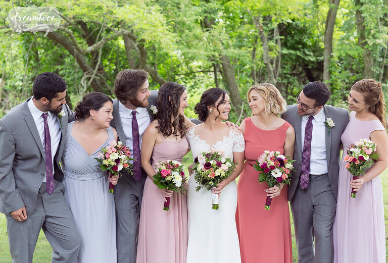 Group photo of the bride with her best friends at this woodsy NY camp wedding.