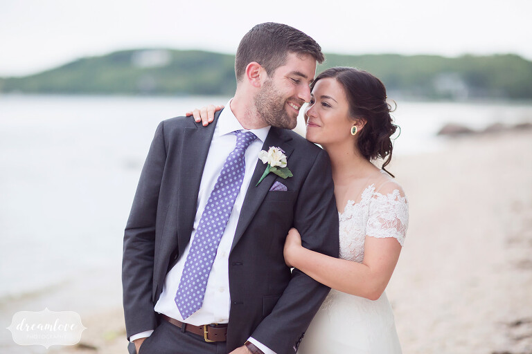 Natural wedding photography of the bride and groom on the beach at their NY camp wedding.