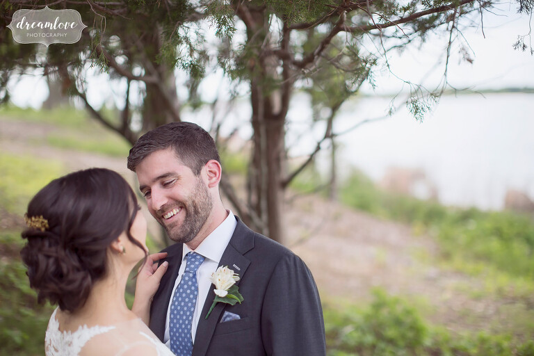 Groom looking into bride's eyes at this NY camp wedding off Long Island.