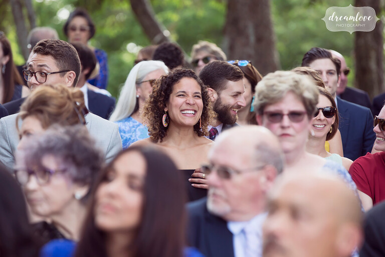 We love to capture candid and happy photos of the wedding guests at our outdoor weddings.