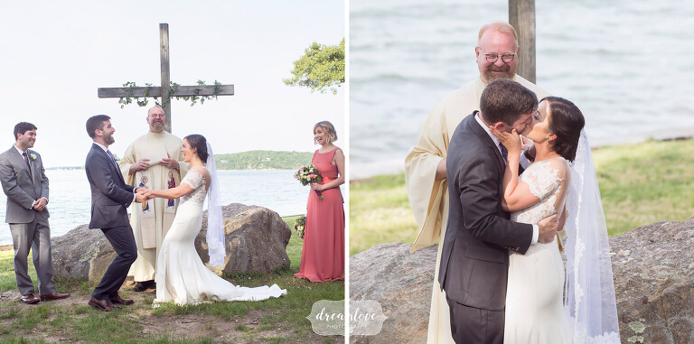 The bride and groom kiss at the end of their outdoor ceremony by the ocean at Camp Quinipet.