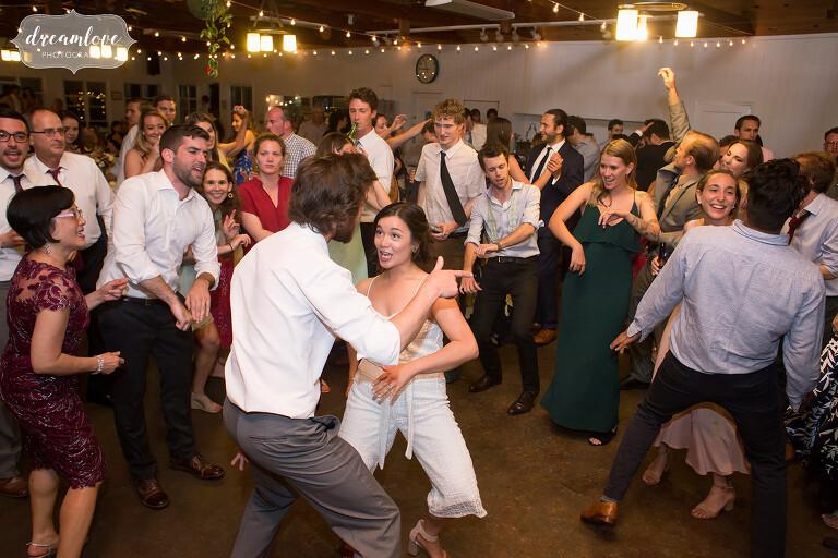 Hilarious photo of the bride dancing at this NY camp wedding.
