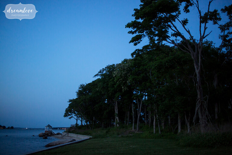 Beautiful twilight blue light over Camp Quinipet and the ocean gazebo at this summer wedding.