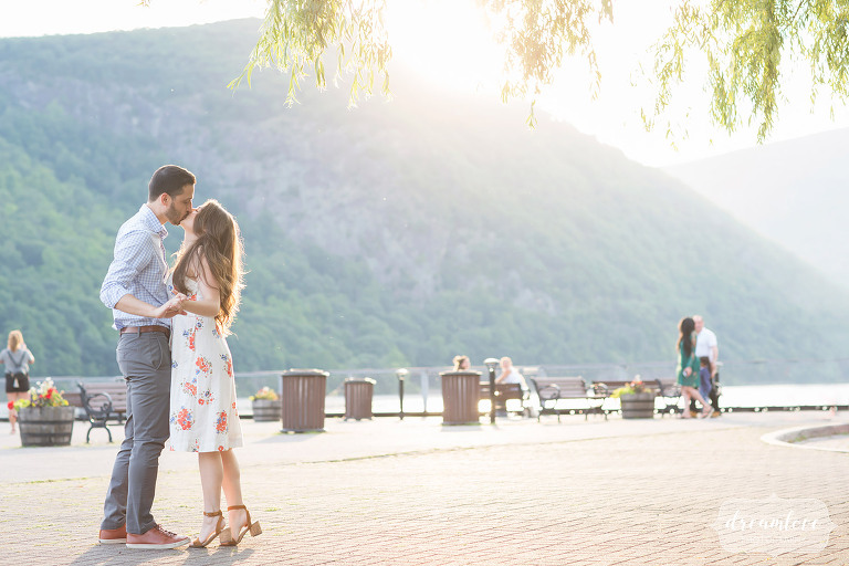 Sunbursty engagement photos of couple kissing in the Hudson Valley in Cold Spring.