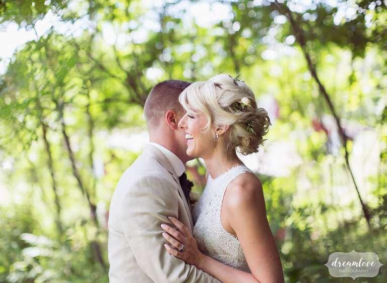 Boho bride hugs groom at Bishop Farm wedding in NH.