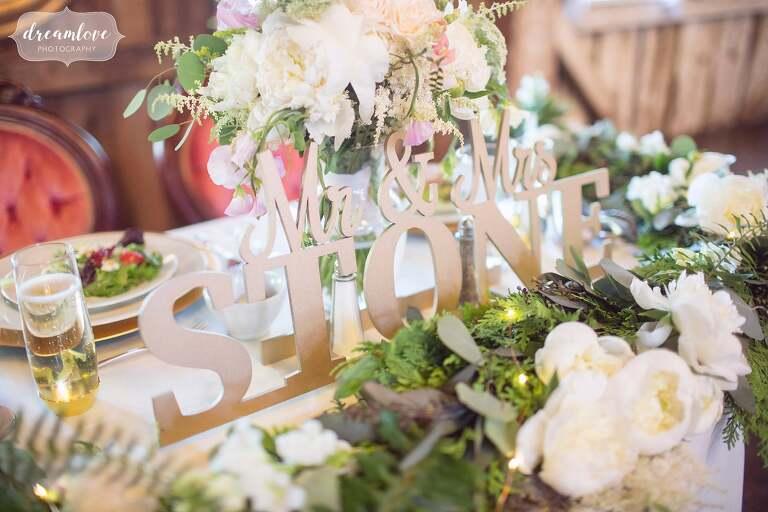 Rustic wood cut decor ideas for this barn wedding at the Bishop Farm wedding venue.