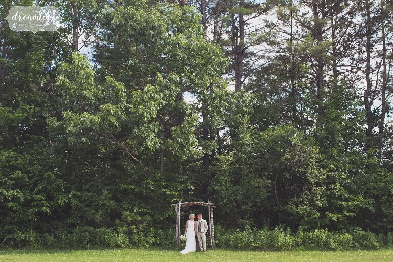 Woodsy wedding portrait of the bride and groom at Bishop Farm venue in NH.