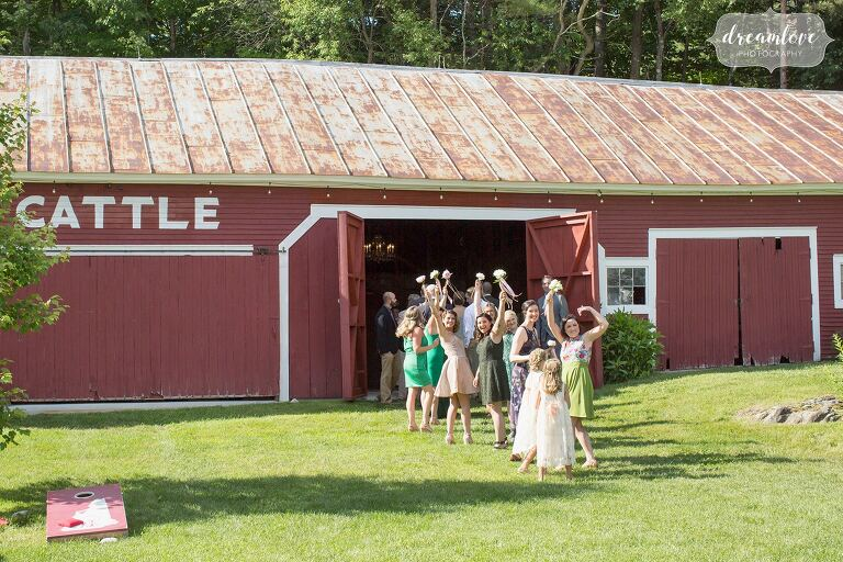 Wedding party waves before ceremony begins at Bishop Farm barn.