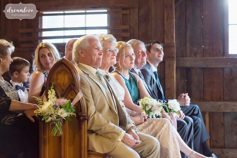 Documentary wedding photos of family watching ceremony at Bishop Farm.