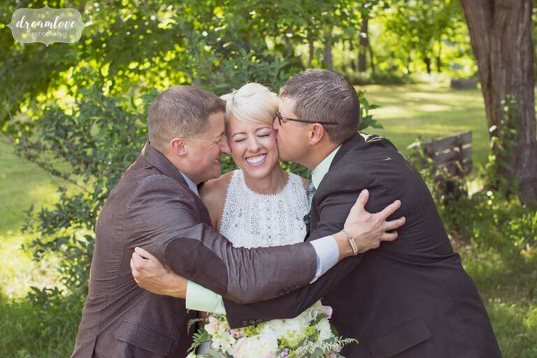 The bride's brothers do a squish face photo at Bishop Farm.