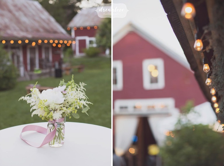 The Bishop Farm is a woodsy barn wedding venue in NH with cafe lights.