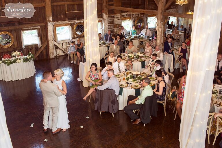 The bride and groom have their first dance at Bishop Farm, captured from high above.