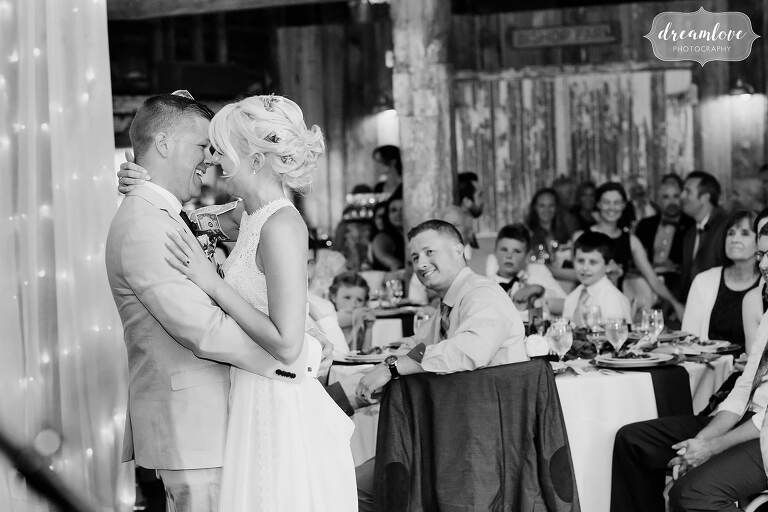 Storytelling wedding photo of bride and groom during first dance at barn wedding in NH.