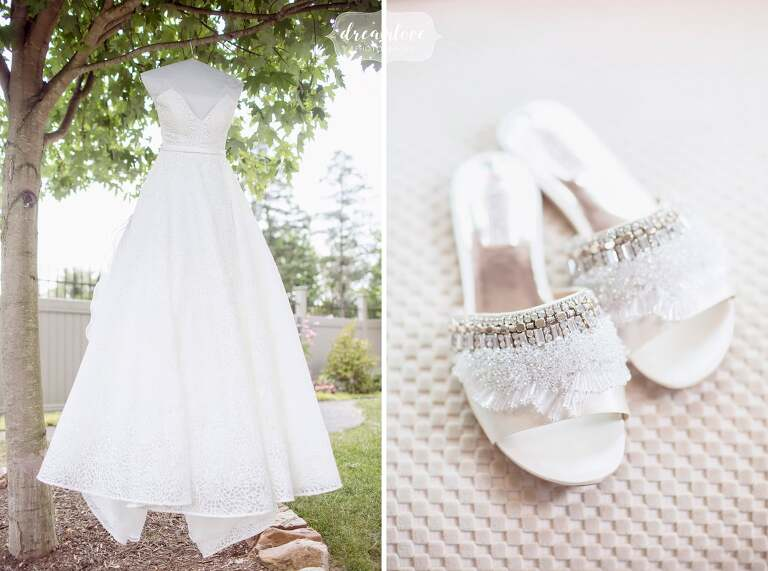 A ballroom wedding gown hangs from a tree in central PA for this wedding.