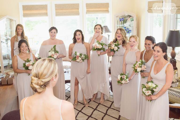 The bridesmaids have their first look seeing the bride in her Kleinfeld gown in PA.