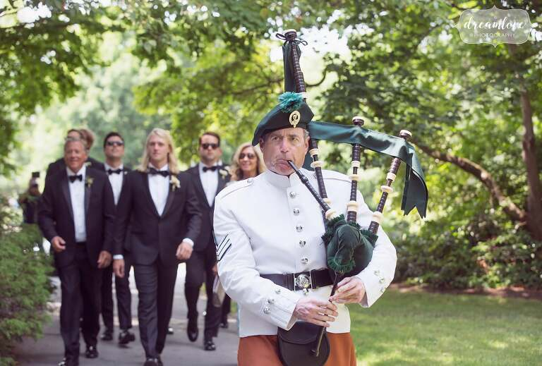 A bagpiper leads the groom and his groomsmen to the chapel on Bucknell campus in PA.
