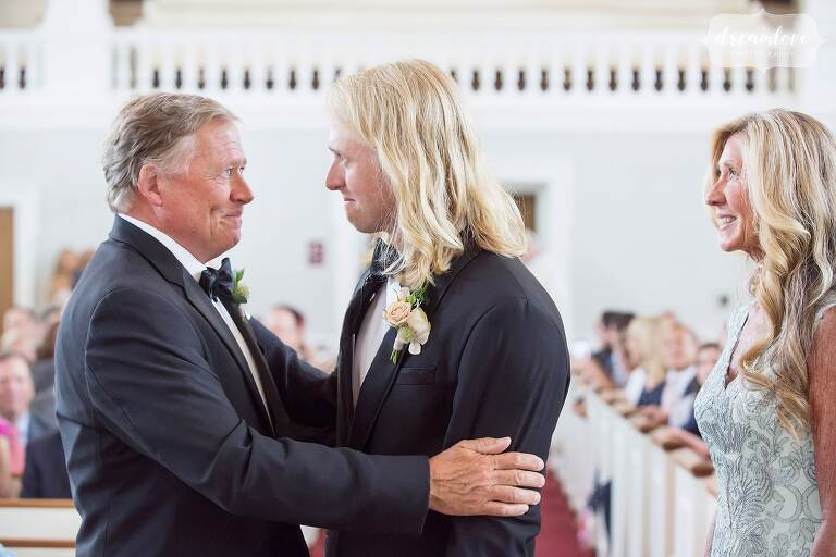 Emotional wedding photo of the father of the groom before the ceremony.