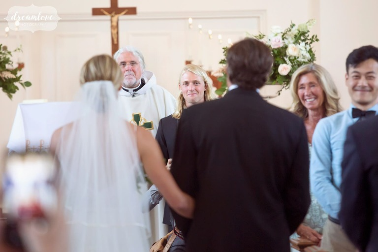 The groom watches the bride walk into Rooke Chapel in Lewisburg, PA.