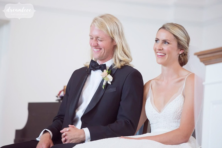 The bride and groom laugh during their chapel wedding ceremony at Bucknell.