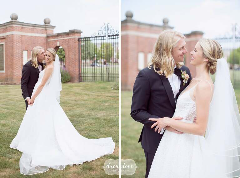 Bride and groom pose in front of gates at Bucknell University.