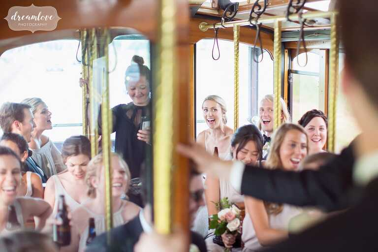Bride and groom ride the Rohrer Trolley after Bucknell University wedding.