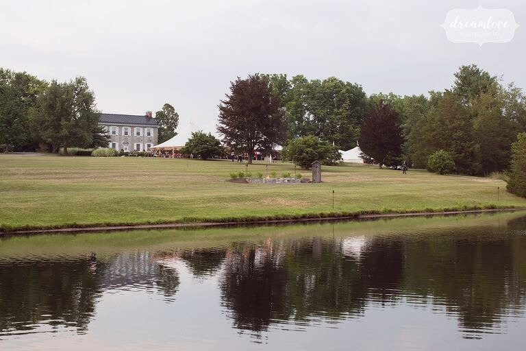 View of the One Barn Farm wedding venue with pond in Mifflingburg, PA.