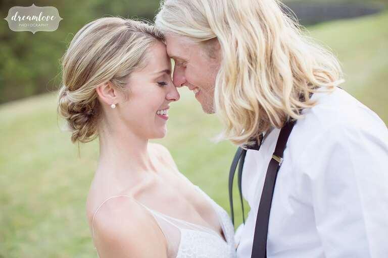 Outdoor wedding photos of bride and groom at One Barn Farm.