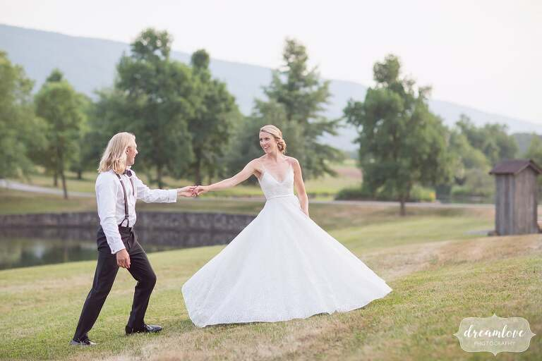 The groom twirls the bride in a field for this central PA wedding.