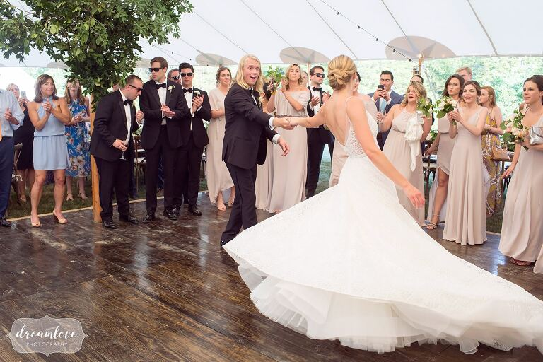 Amazing photos of the bride spinning in dress at One Barn Farm.