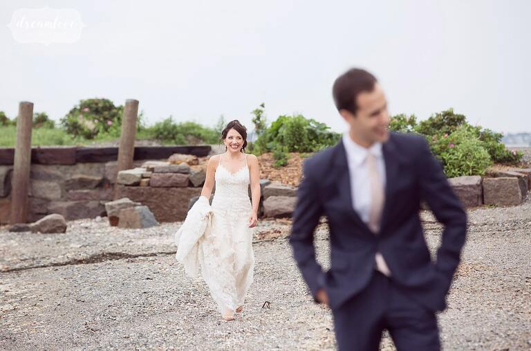 The bride and groom have their first look on the beach at this Boston Harbor wedding on Thompson Island.