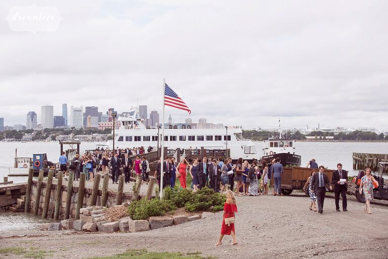 Guests arrive on big ferry for Boston Harbor wedding.