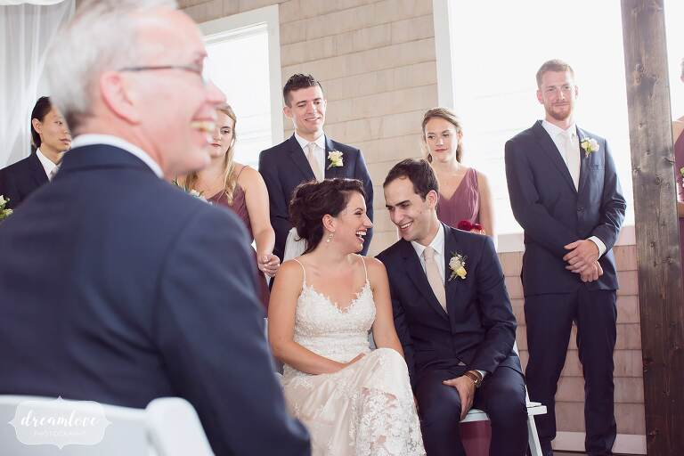Bride and groom laughing during indoor ceremony Thompson Island.