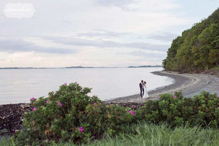 Fine art wedding photography of bride and groom on the beach on Thompson Island.