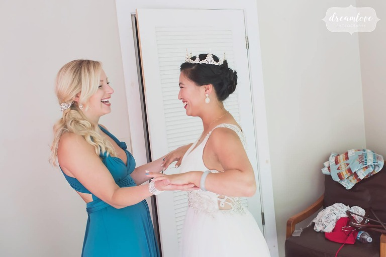 Great documentary photo of the bride hugging her friend before this small wedding.
