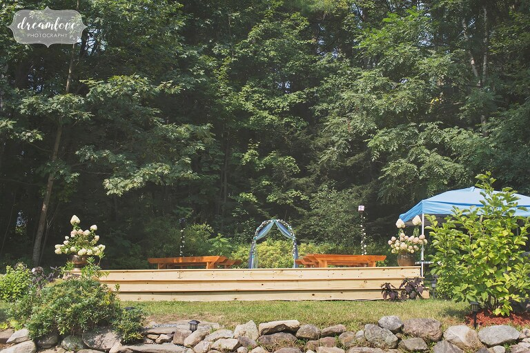 Example of a small backyard wedding set up with long benches in NH.
