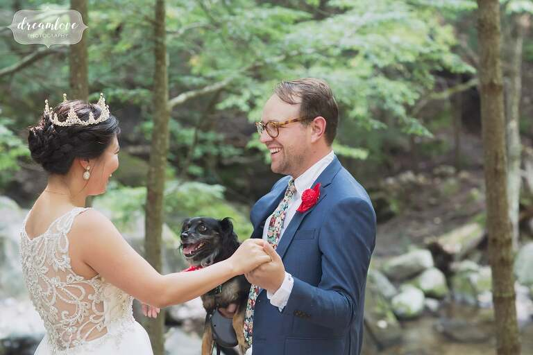 The groom looks at his bride after their first look in the woods in NH.