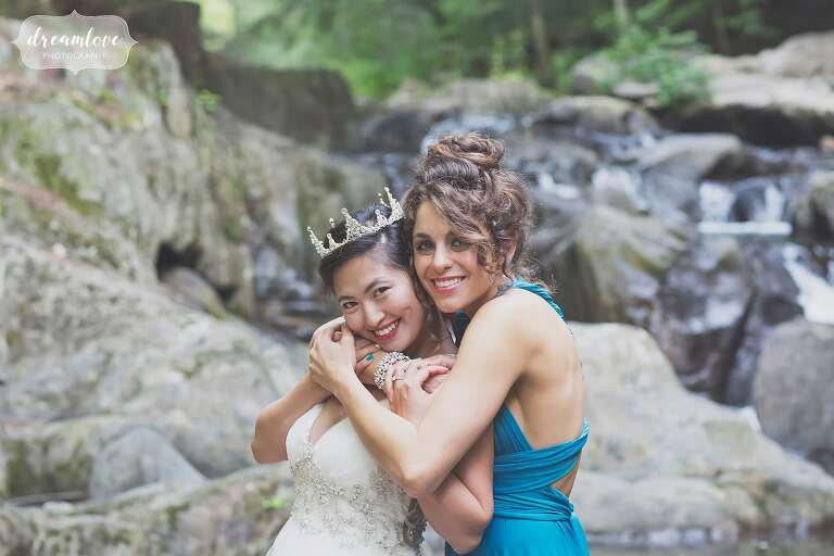 Bride and her best friend by the creek for this backyard wedding.