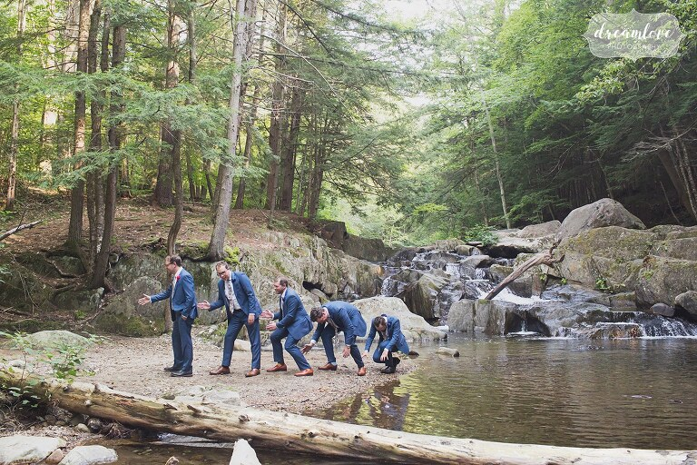 Hilarious groomsmen pose evolution of man by the creek for this backyard wedding.