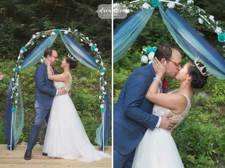 Ceremony kiss during backyard wedding in NH.