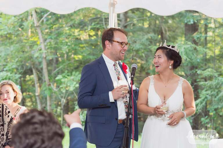 Bride and groom give speech at NH wedding.