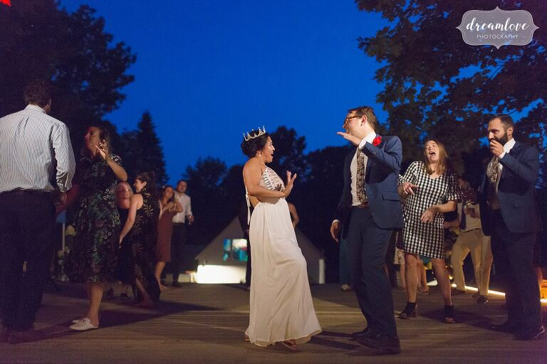 Bride and groom do silly dance in Hanover, NH.